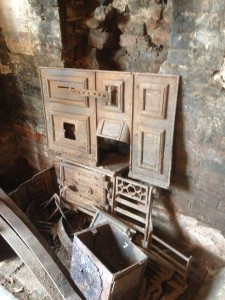 Rusting oven and fireplace is uncovered