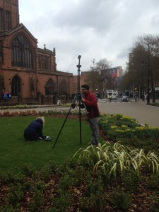 A man uses a tripod to scan a medieval church