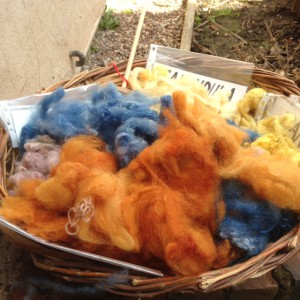 A basket of wool dyed with natural blue and yellow, orangedyes.