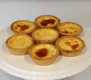 A plate of small baked custard pastries