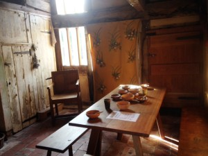 A small medieval room with simple furniture