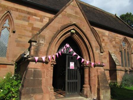 the church entrance with pink Heritage Open Days bunting