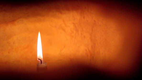 A candle gives an orangey light