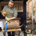 woodcarver carving log