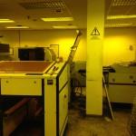 yellow lit room of machinery