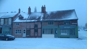 The front view of the House and Terrace in the snow