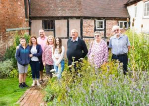 A group of people of varying ages in the garden