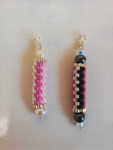 Cylinder shaped jewellery covered in small beads