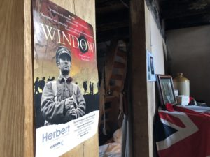 A poster for The Window play depicts a young man in uniform