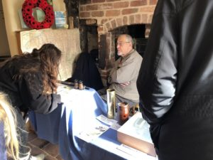 Visitors looking at a display of WW1 artefacts