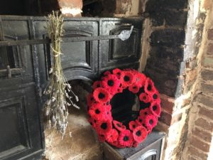 A wreath of woven poppies