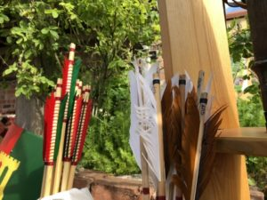 Red and green fletched arrows, white and brown fletched arrows