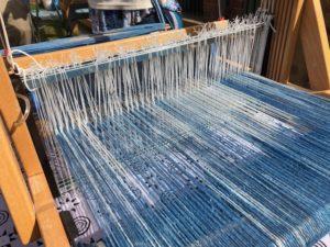blue threads on a loom