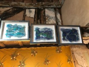 Framed textile art in medieval house, beams and wall