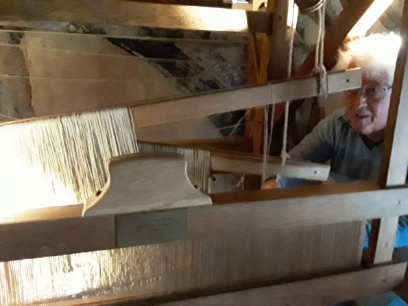 plain wool is carefully added to the loom