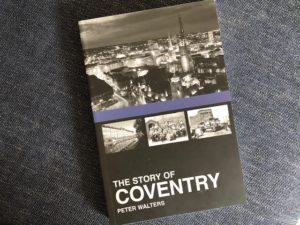 cover of book showing city scape at night, black and white
