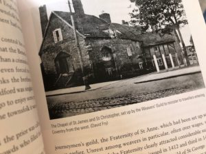 page of text including a photo of an old building