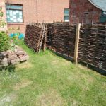 lawned area and newly installed wattle fencing