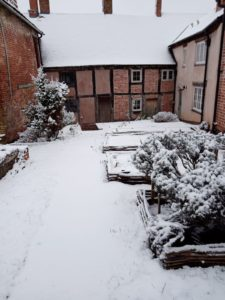 The Weaver's House and garden, covered in a layer of snow