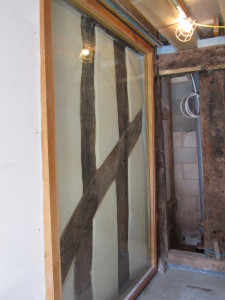 glass pane over medieval timbered wall