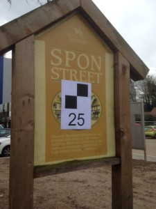 Black and white chequered squares and number 25 on a sign in Spon Street.