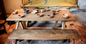 wooden bowls and cups on a wooden table