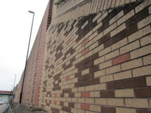 Close detail of patterns formed by different coloured bricks in a wall.