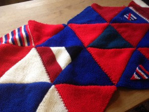 red white and blue bunting triangles joined together to make a blanket