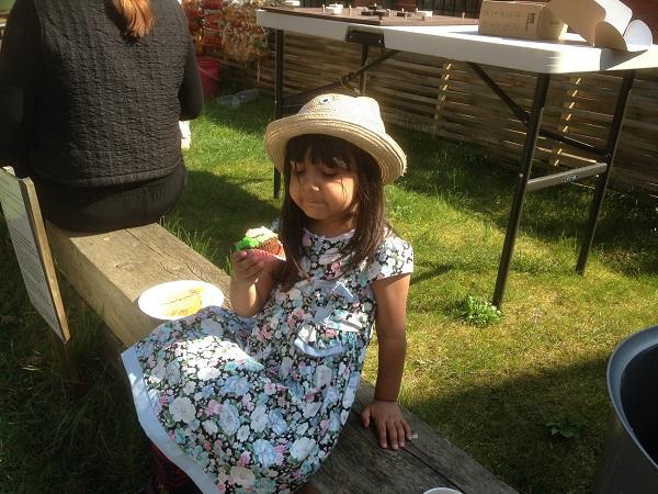 little girl eating cake