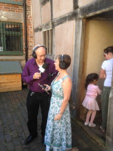 a man interviewing a woman with radio mic