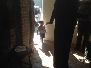 little boy in doorway
