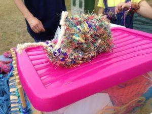 a fluffy multi coloured snail