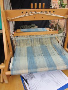 weaving loom with blue fabric