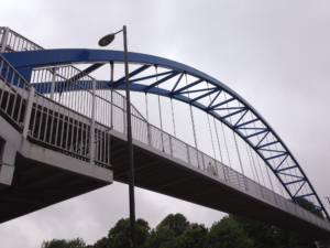 a bridge over the ringroad with blue arch
