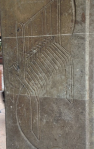 an incised picture of a loom on stone