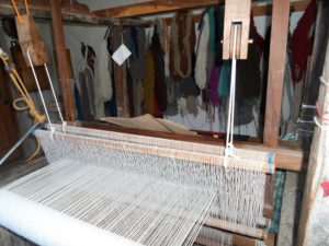 The warp and weft (strings) of a loom