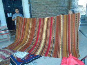 Striped carpet in reds, orange and gold tones