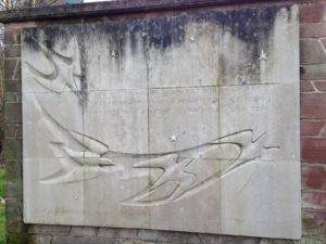 Incised stone plaque depicting birds in flight and inscribed text