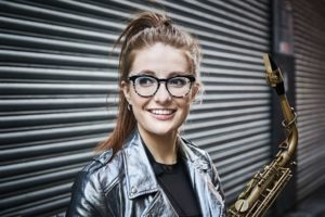 smiling young woman with saxophone