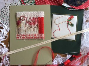 Embroidery with red thread, Christmas stocking and robin