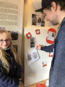 Two young people add a memory to the board