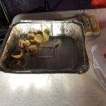 A big silver foil tray with a few small bread cups