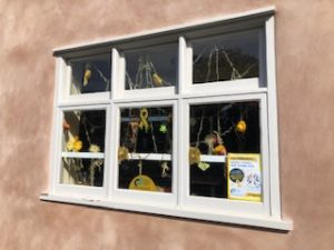 the window decorated for Childhood Cancer Awareness Month