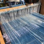 blue threads on a loom