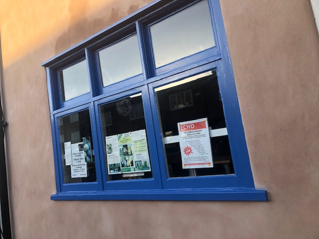 window frame painted a mid bright blue