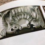 Carved stone fish emblem