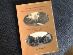 cover showing title and two old photos of the cemetery gates