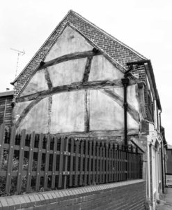 the end of the terracce showing the wooden timber structure of the house