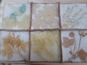six squares of blanket sewed together with different plan and flower outlines