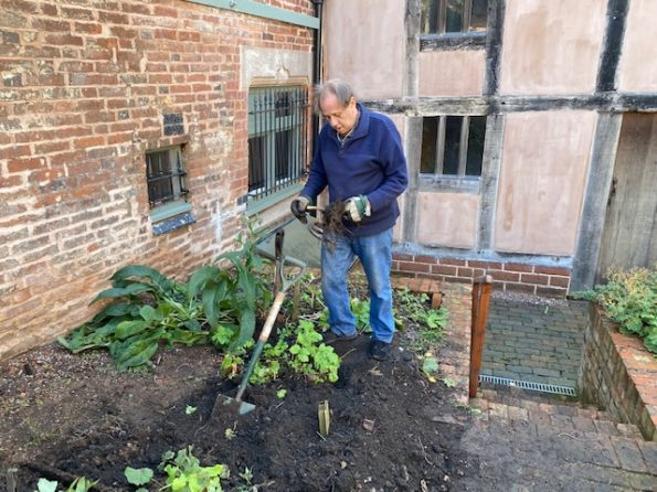 A man digs over a garden bed